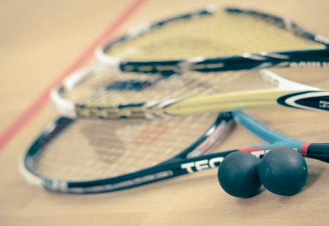 A collection of squash equipment.