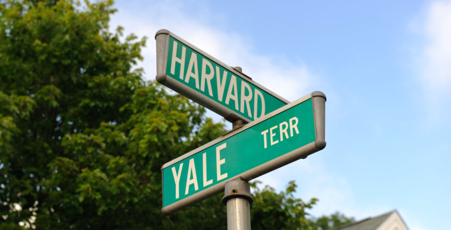 A street sign promoting 'Harvard' and 'Yale' terrace.