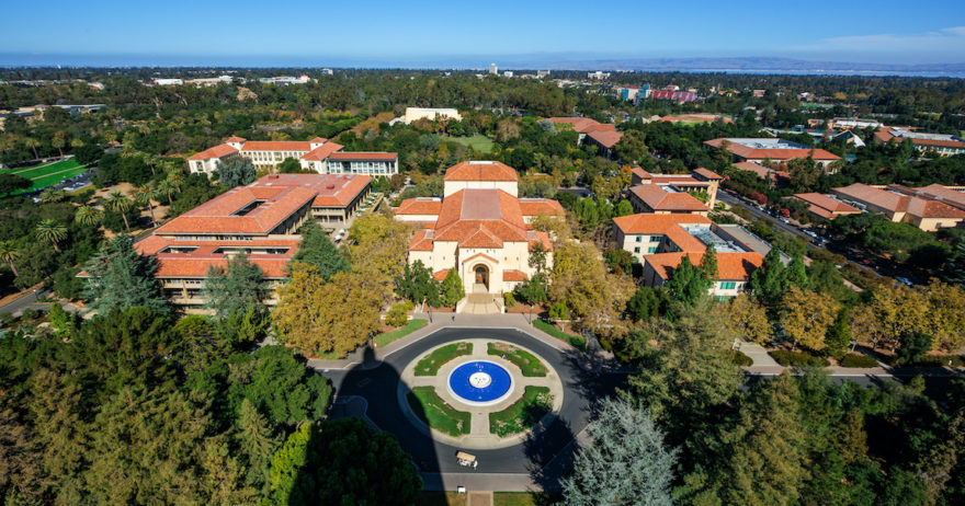 An overhead drove perspective of the main fountain on the Stanford campus.