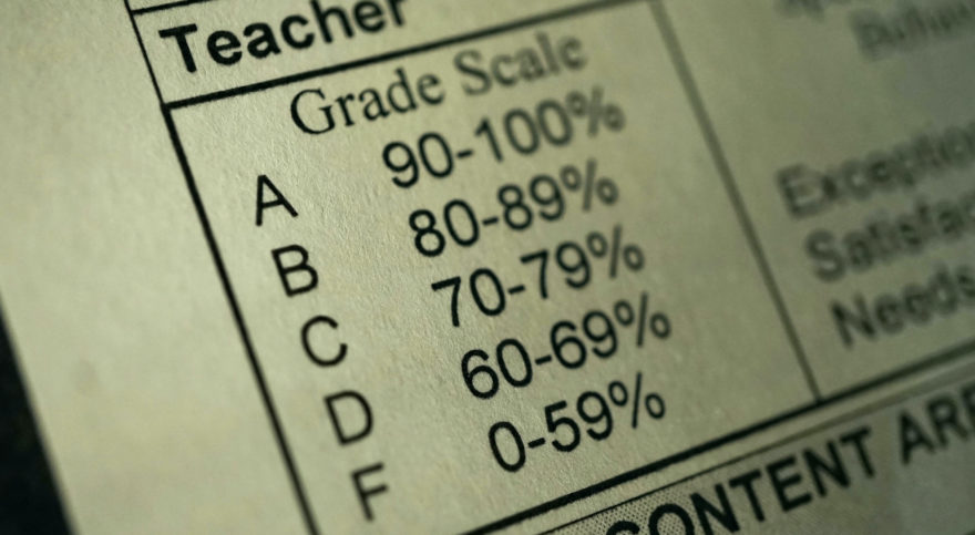 A grade scale explanation table from a standardized testing form.