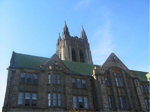 The large stone face of one of the massive buildings in Massachusetts.