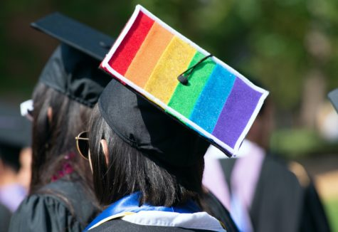 A graduating senior with the LGBTQ flag on her graduation cap.