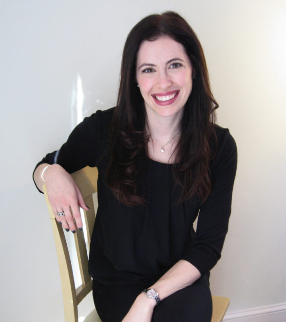 Rachel Rubin of Spark Admissions seated in chair smiling